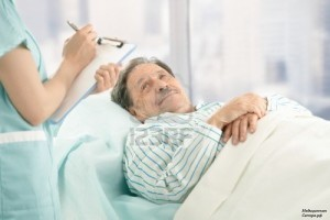 1365413157_7792088-nurse-holding-clipboard-taking-notes-of-old-patient-lying-in-hospital-bed
